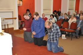 Our three Postulants pray in preparation for their reception of the Tau Cross