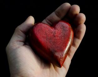 red-heart-in-hands
