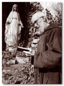 Fr. Solanus at the Lourdes Grotto in the friary garden in Detroit where he minstered as the doorkeeper for nearly 40 years.