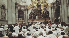 The concelebrant friars before the Altar of the Chair of Peter