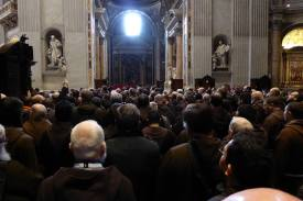 The friars approach the Holy Door of the Jubilee Year