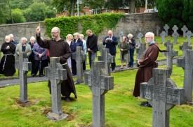 Br Martin Bennett OFM Cap. blessing the graves